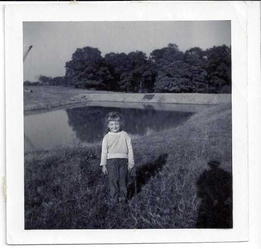 Manzke Lake is seen behind Bob's little sister, Ginny.