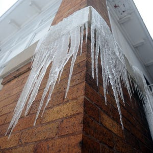 Icicles hang from a building downtown.