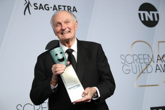 A jubilant Alan Alda poses with his Life Achievement Award backstage at the SAG Awards.