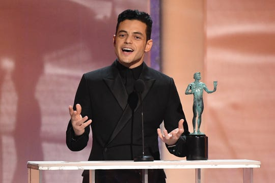 "Ready, Freddie! Rami Malek accepts the SAG Award for best male actor in a leading role for playing Queen's Freddie Mercury in ""Bohemian Rhapsody."""