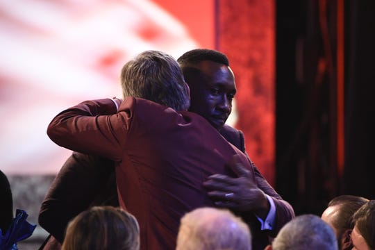 Mahershala Ali embraces co-star Viggo Mortensen as he accepts his supporting actor award at the Screen Actors Guild Awards.