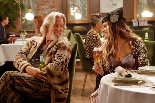 Jeff Bridges, left, and Sarah Jessica Parker bring back a few of their iconic roles for Stella Artois' Super Bowl commercial.