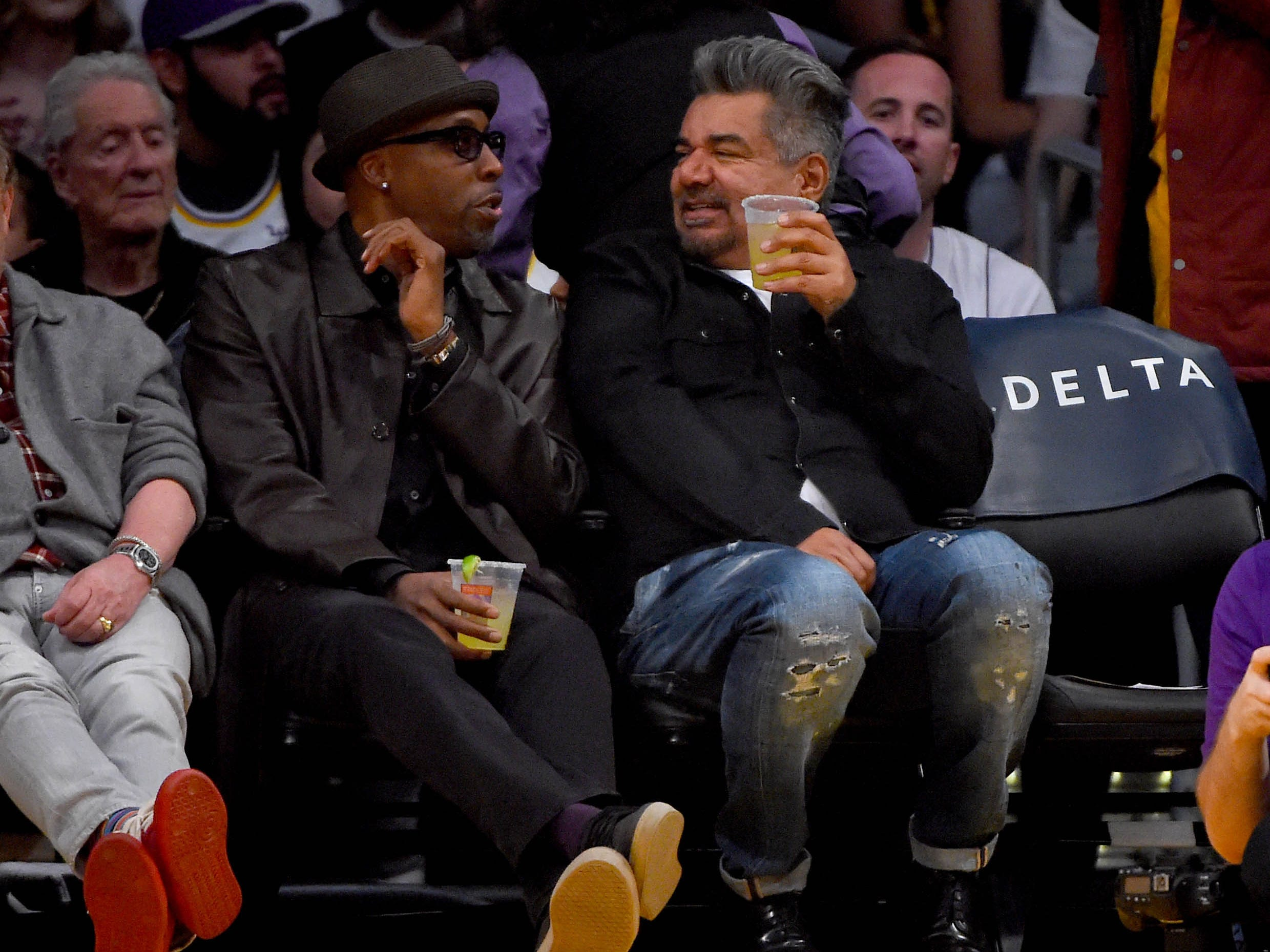 Jan. 27: Arsenio Hall and George Lopez take in the Lakers-Suns game at Staples Center in Los Angeles.