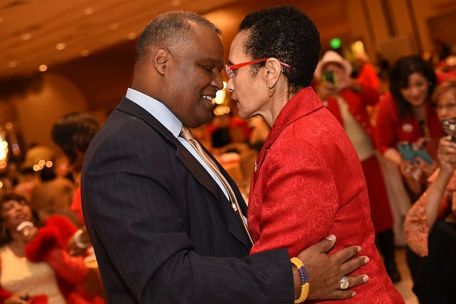 Rushern Baker, former Prince George's County, MD., Executive, dances with his wife, Christa, who is afflicted with Alzheimer's.
