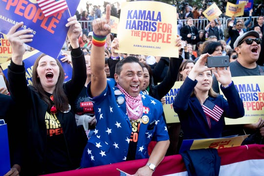 Robert Camacho (C) cheers as California Senator Kamala Harris launches her presidential campaign on January 27, 2019 in Oakland, California. (Photo by NOAH BERGER / AFP)NOAH BERGER/AFP/Getty Images ORG XMIT: Kamala Ha ORIG FILE ID: AFP_1CQ7VB