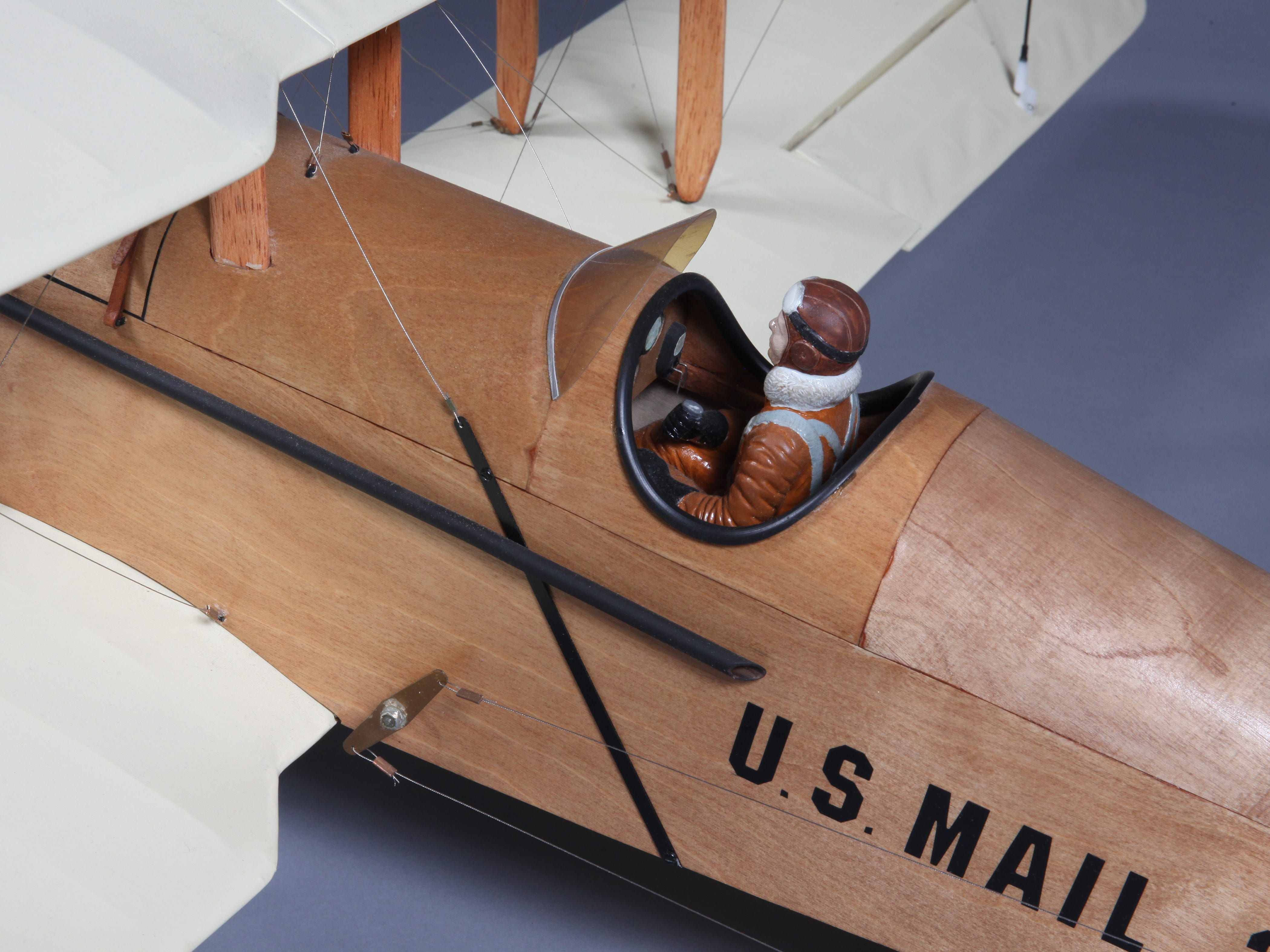 """Part of the """"Airmail to Email"""" exhibit, this is a model of an original airmail plane."""