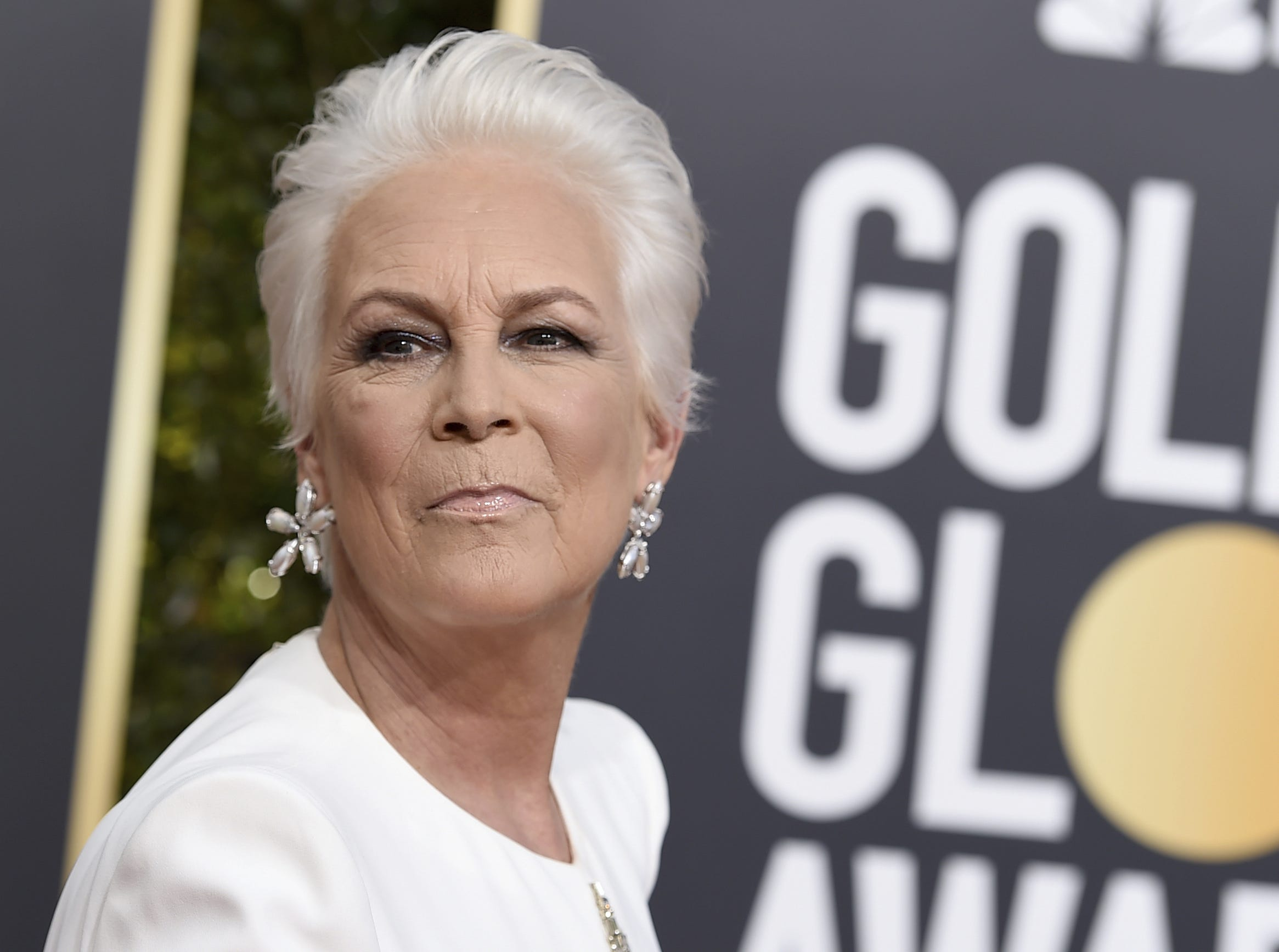 "FILE - In this Sunday, Jan. 6, 2019 file photo, Jamie Lee Curtis arrives at the 76th annual Golden Globe Awards at the Beverly Hilton Hotel in Beverly Hills, Calif. Jamie Lee Curtis is working to tell the story of an Oklahoma City woman whose pledge to stand in as a mom at same-sex weddings went viral. Curtis confirmed through a publicist Friday, Jan. 25, 2019 that she has acquired the rights to ""How We Sleep At Night: A Mother's Memoir,"" by Sara Cunningham. Curtis said she was among the thousands who saw Cunningham's July Facebook post offering to be a surrogate mother. The two eventually met, and Curtis says she is working on a deal to get Cunningham's story onscreen.(Photo by Jordan Strauss/Invision/AP, File)"