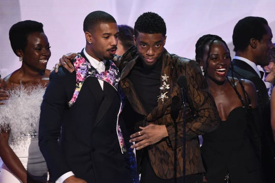 """Danai Gurira (from left), Michael B. Jordan, Chadwick Boseman and Lupita Nyong'o celebrate as the """"Black Panther"""" cast accepts the award for outstanding ensemble at the Screen Actors Guild Awards."""