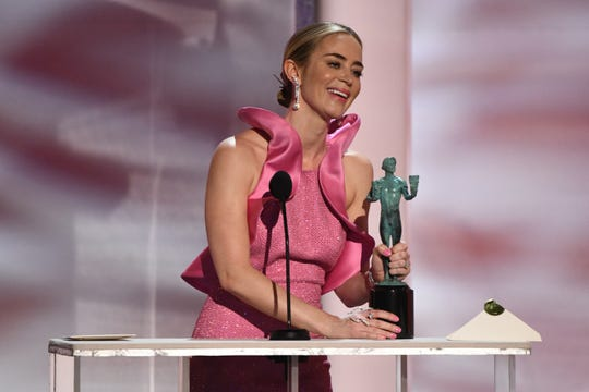 """Emily Blunt accepts the award for outstanding performance by a female actor in a supporting role for """"A Quiet Place."""""""