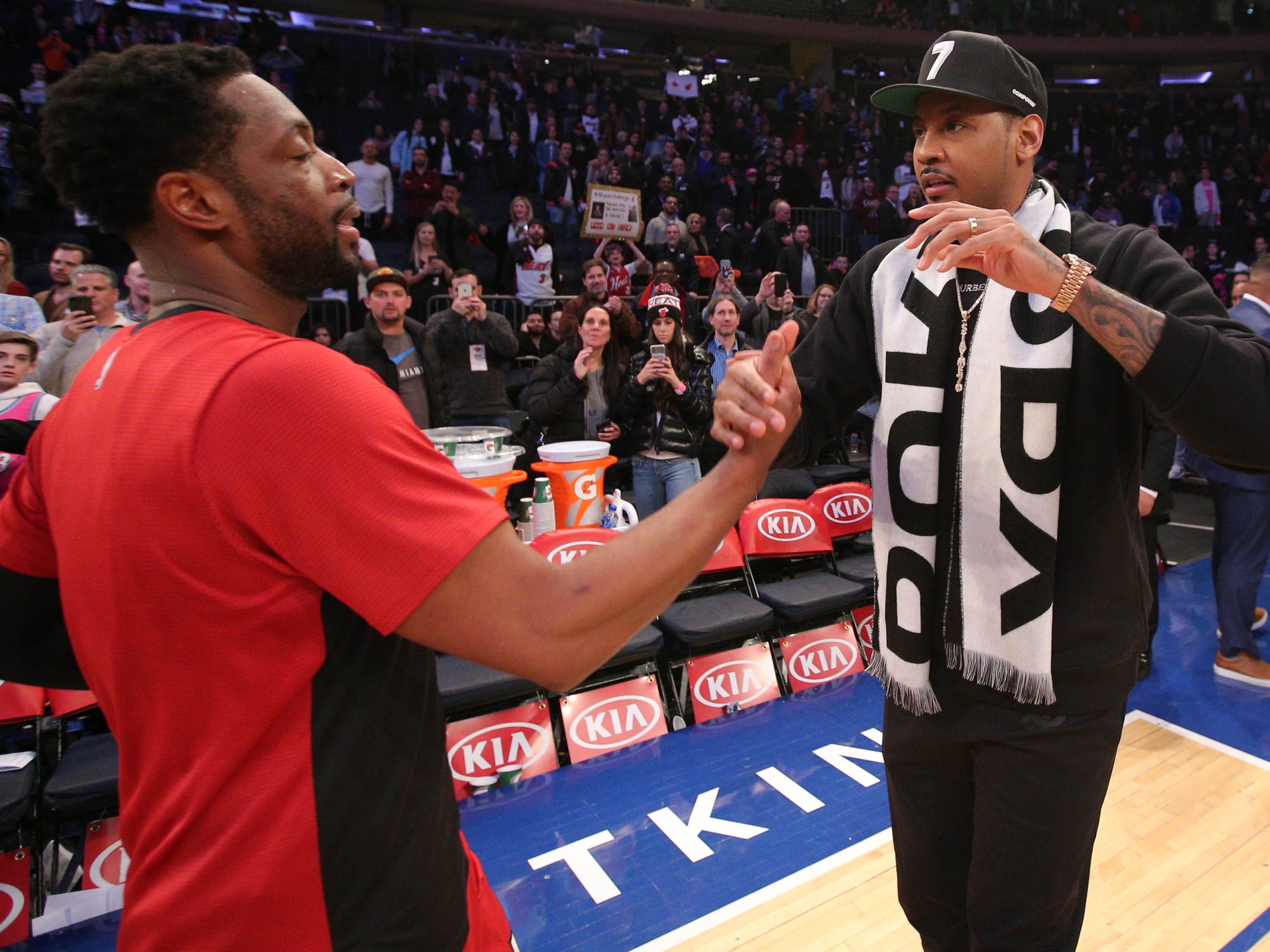 Jan. 27: Heat guard Dwayne Wade shares a moment with his good pal Carmelo Anthony after playing the Knicks in New York. Anthony took in the game as a spectator as Wade made one of his final appearances at Madison Square Garden.