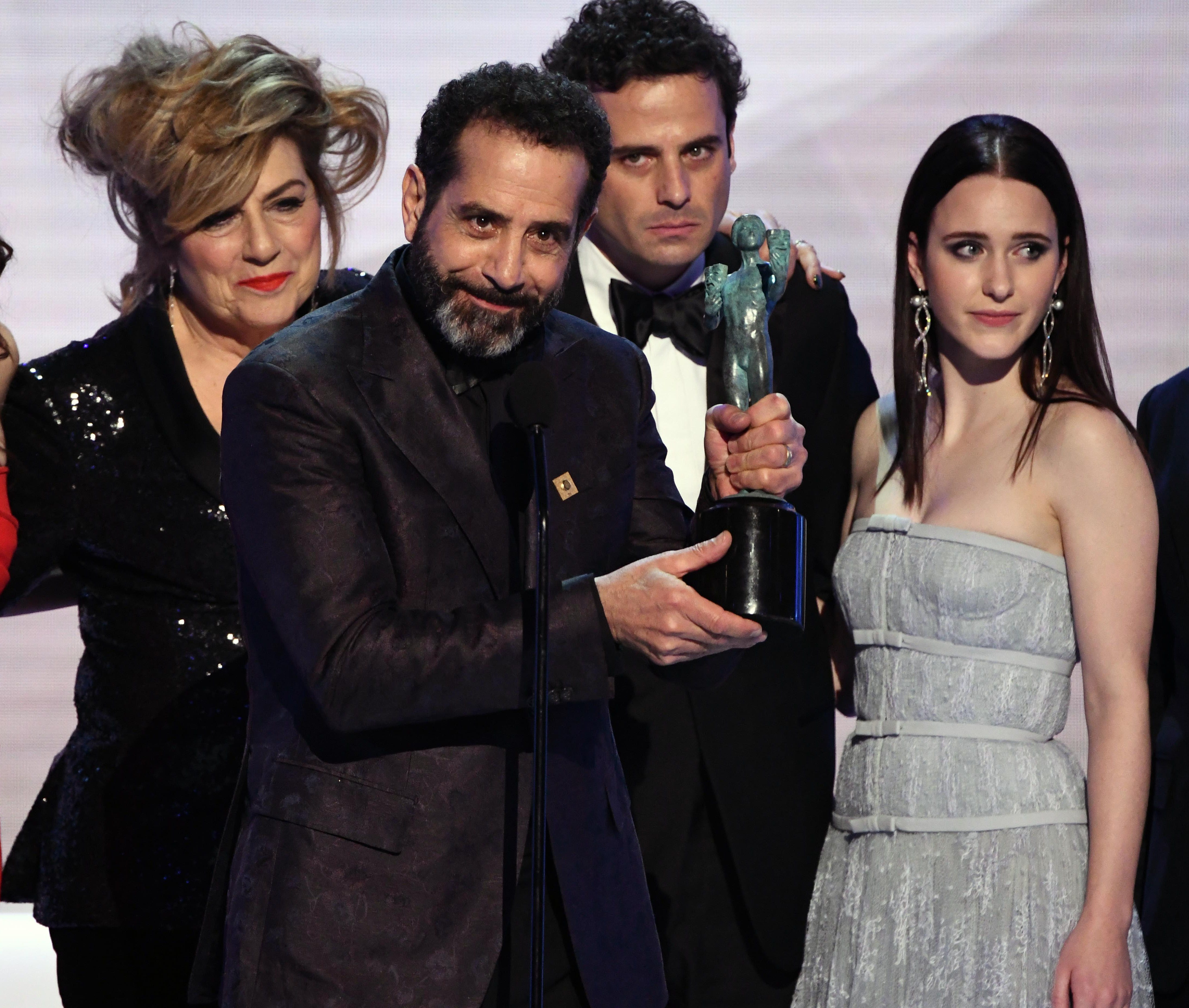 """Tony Shalhoub, center, and the cast of """"The Marvelous Mrs. Maisel"""" accept the award for outstanding performance by an ensemble in a comedy series."""