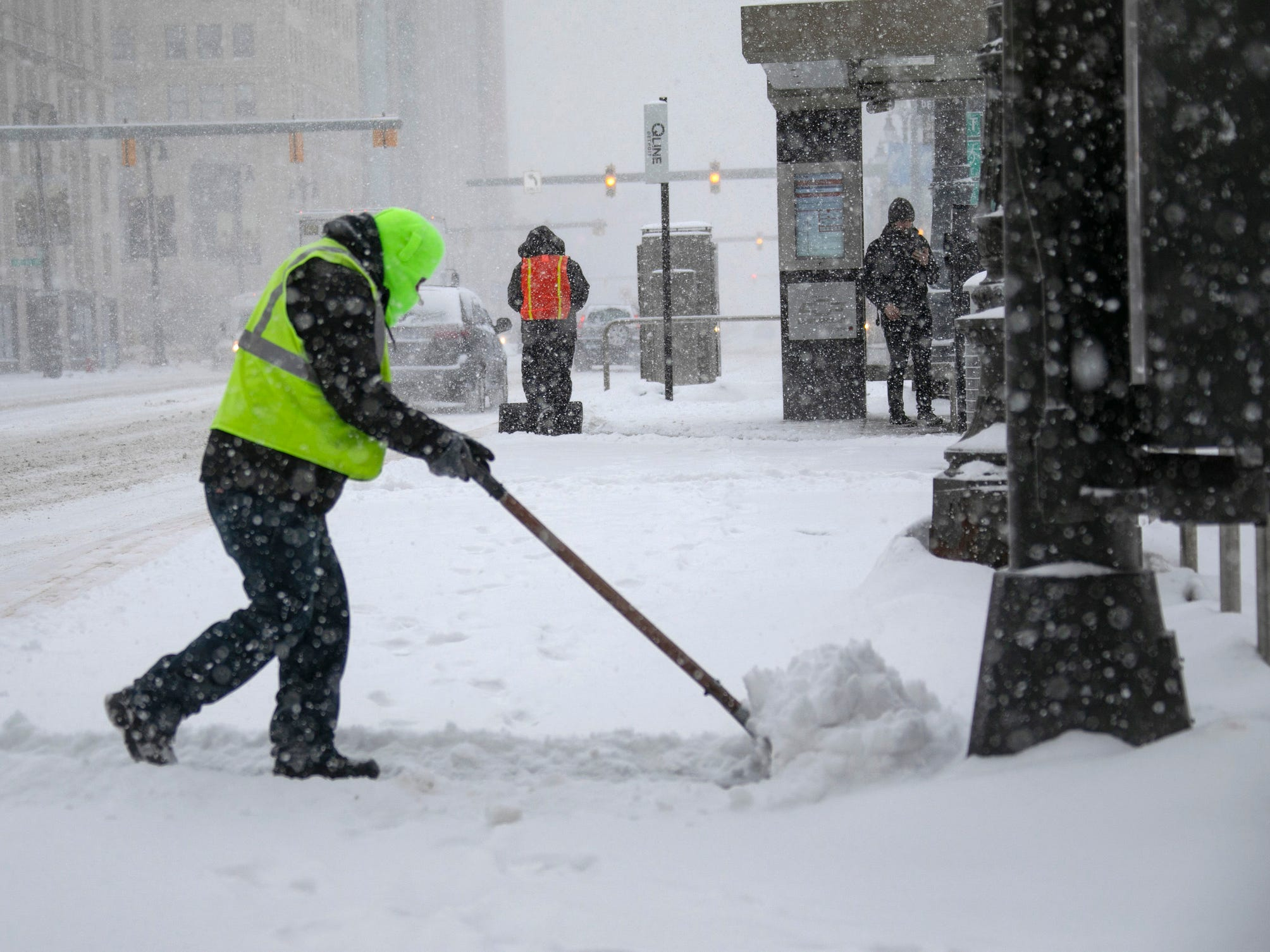 Qline employee Jorge Aguilar shovels snow in Detroit, Jan. 28, 2019.