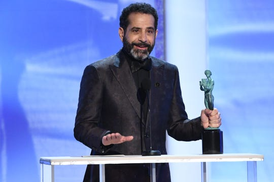 """Tony Shalhoub accepts the award for outstanding performance by a male actor in a comedy series for his role as Abe Weissman in """"The Marvelous Mrs. Maisel."""""""