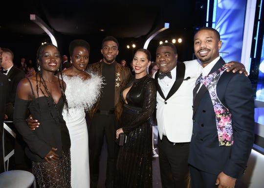 Lupita Nyong'o, Danai Gurira, Chadwick Boseman, Megan Wollover, Tracy Morgan, and Michael B. Jordan pose for a pic during commercial break.