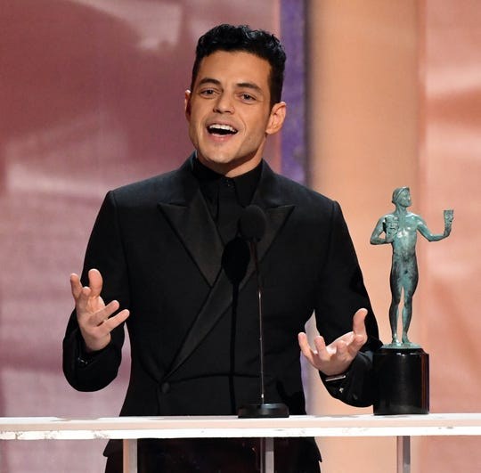 "Rami Malek got a big hug from Bradley Cooper on his way to the stage to accept best lead actor for his role as Freddie Mercury in ""Bohemian Rhapsody."""