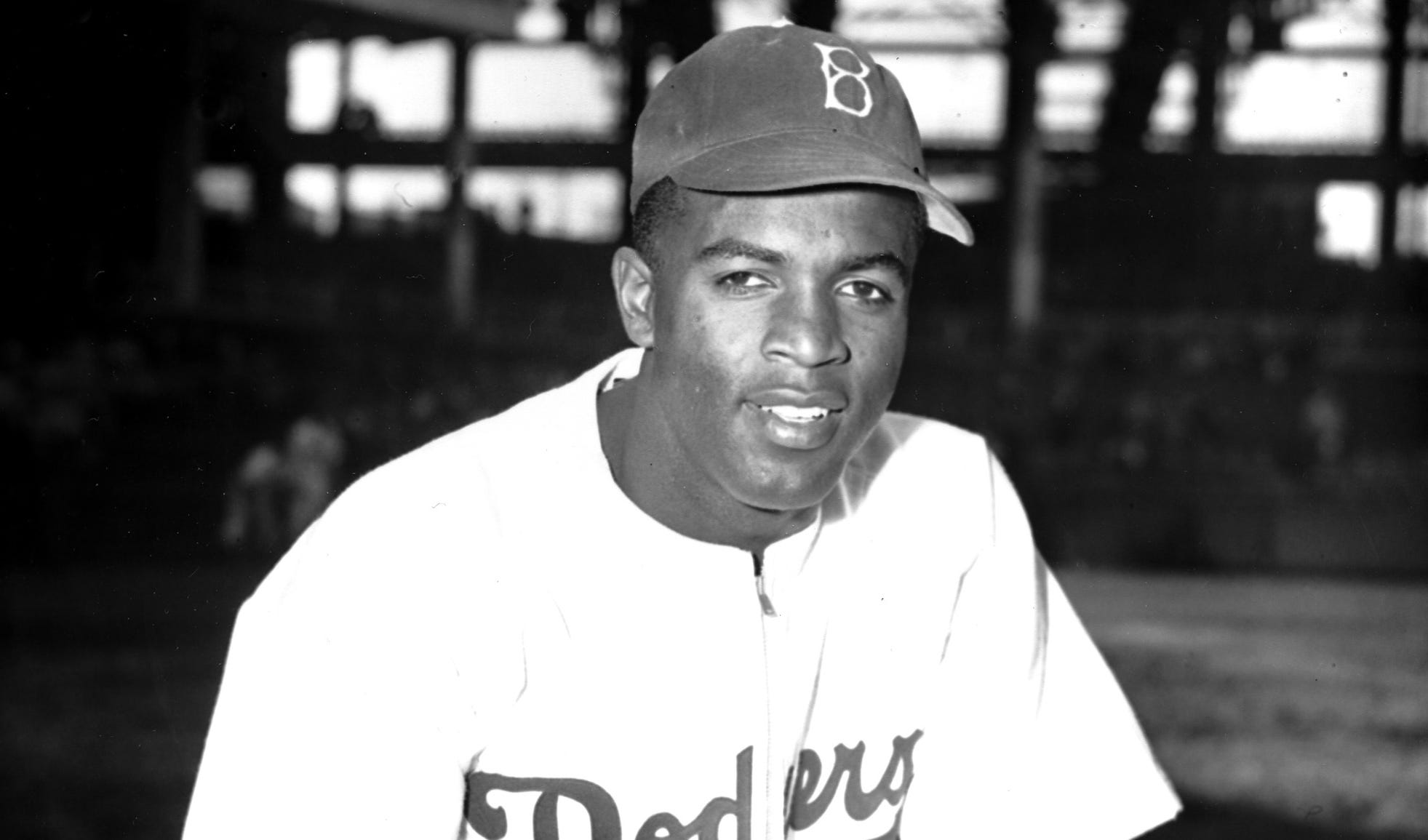 Robinson poses at Ebbets Field in April 1947.