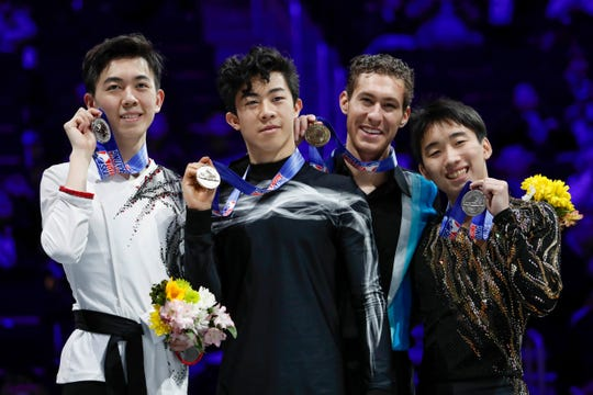 (Left to right) Vincent Zhou (silver medal), Nathan Chen (gold medal), Jason Brown (bronze medal) and Tomoki Hiwatashi (pewter medal) celebrate following the 2019 Geico U.S. Figure Skating Championships.