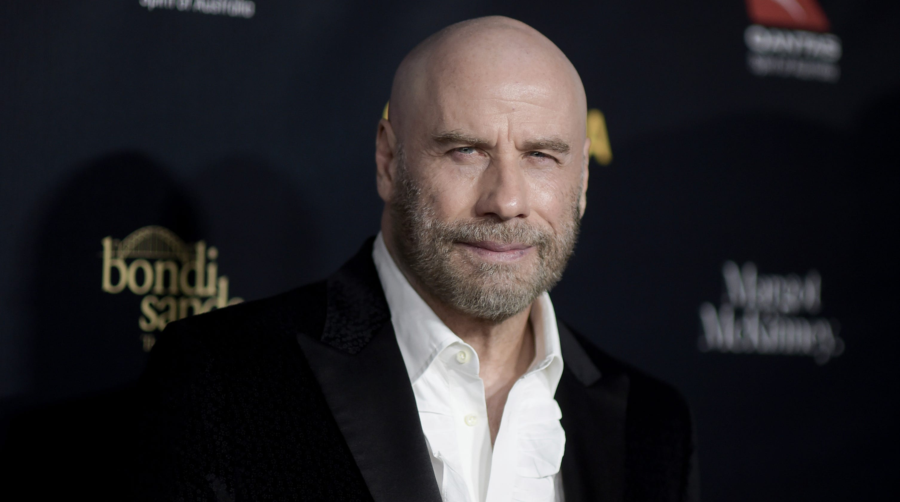 John Travolta Is Keeping The Cool Bald Look And It Feels Great