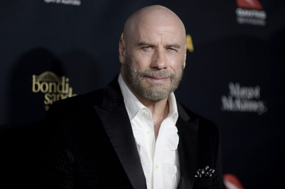 John Travolta and his bald head attend the 2019 G'Day USA Los Angeles Gala on Saturday.
