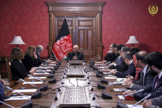 In this photo released by the Afghan Presidential Palace, Afghan President Ashraf Ghani, center, speaks to U.S. peace envoy Zalmay Khalilzad, third left, at the presidential palace in Kabul on Jan. 28, 2019.