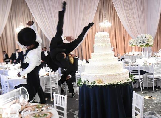 Von Miller flips Tony Gonzalez into a cake.