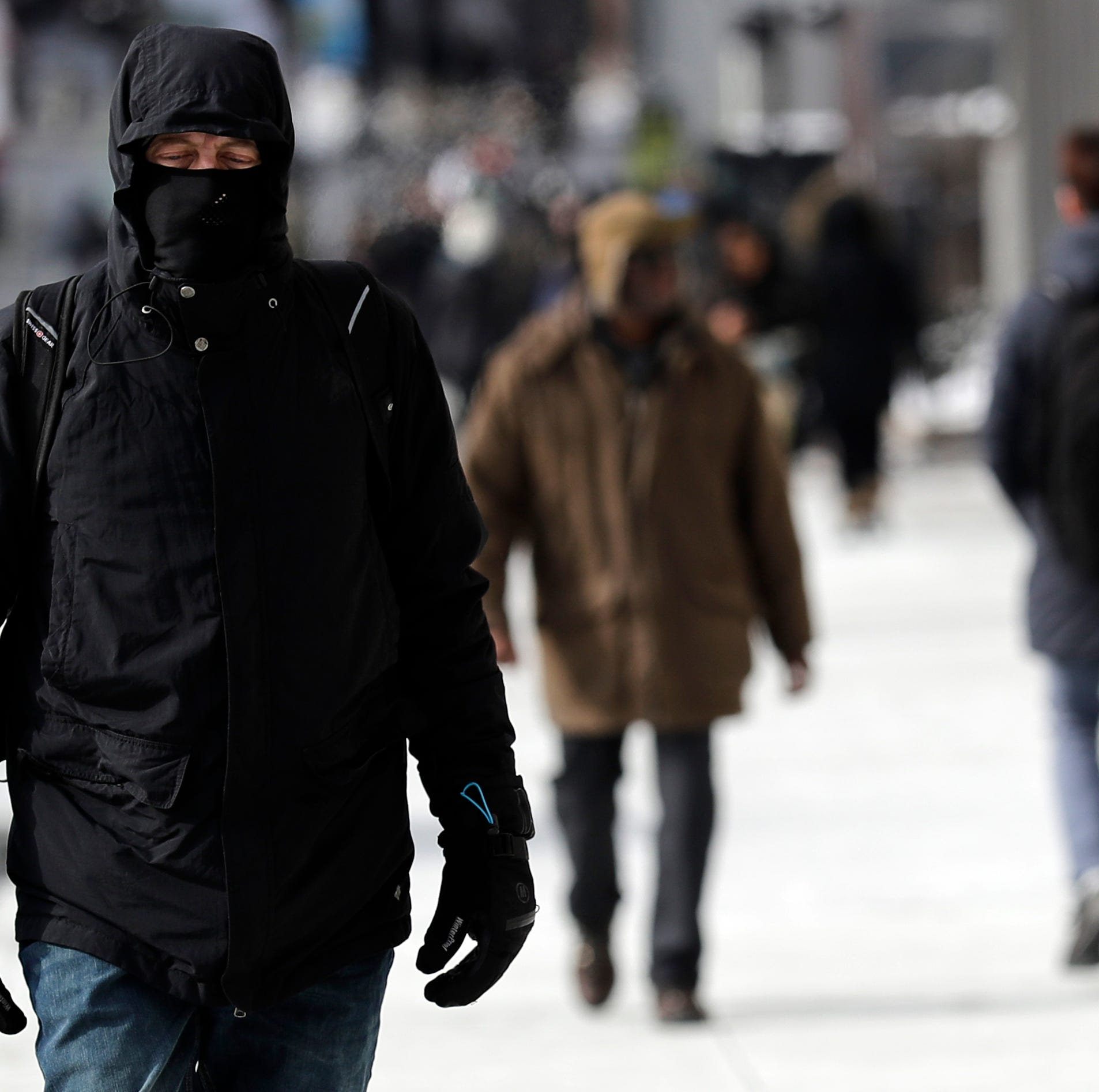 A man is bundled up against Chicago's cold, in downtown Chicago, Sunday, Jan. 27, 2019.