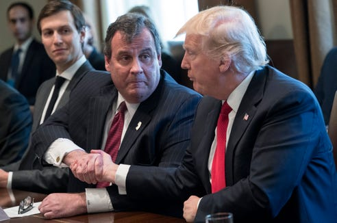 President Donald Trump shakes hands with New Jersey Gov. Chris Christie during an opioid and drug abuse listening session in the Roosevelt Room of the White House in Washington, on March 29, 2017.