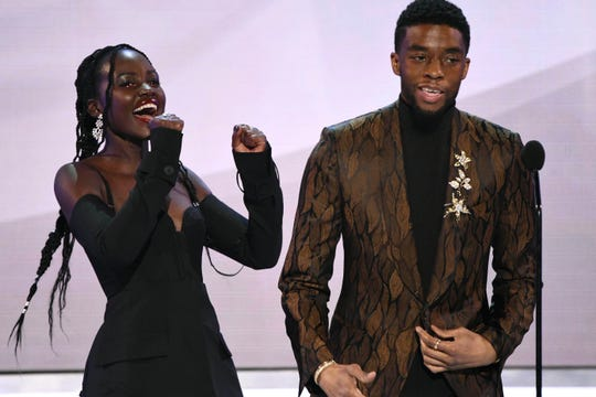 "Lupita Nyong'o and Chadwick Boseman take the stage as the actors of ""Black Panther"" accept the award for outstanding performance by a cast."