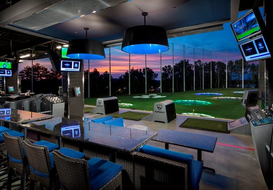 TopGolf is a high-tech entertainment center that also has a bar, restaurant and rooftop fire pit.