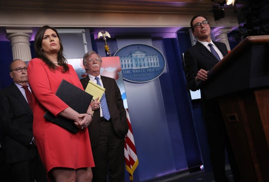 Left to right: Director of the National Economic Council Larry Kudlow, White House press secretary Sarah Sanders, National Security Adviser John Bolton and Treasury Secretary Steve Mnuchin during Monday's briefing.