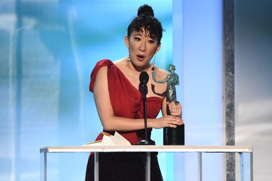 "Sandra Oh thanks her fellow actors for years of encouragement as she accepts the award for outstanding female actor in a drama for ""Killing Eve."""