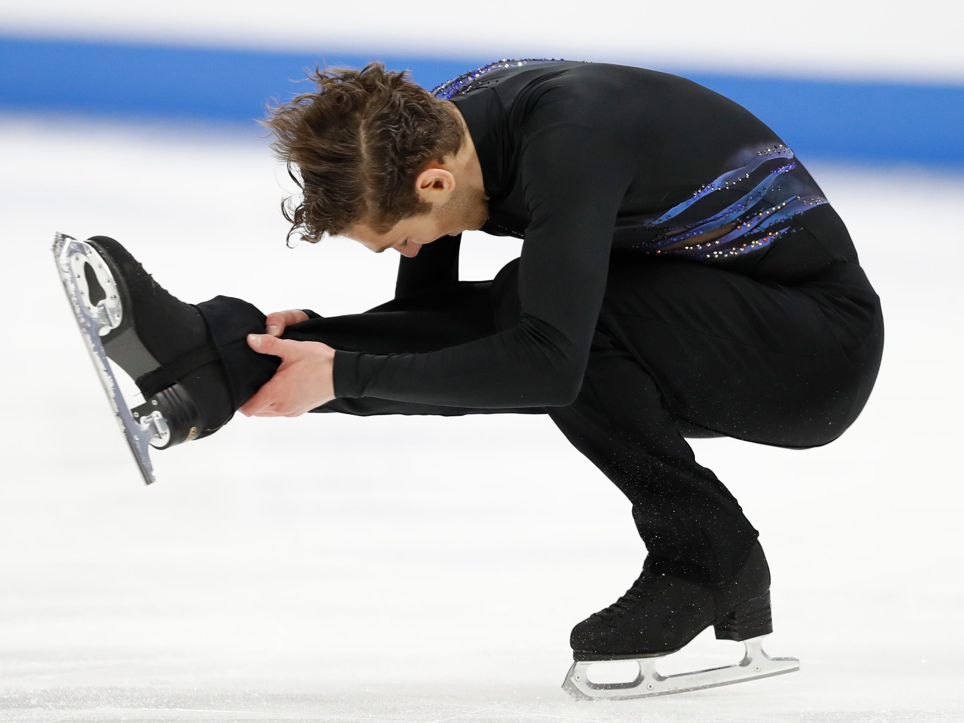 Third-place mens' finisher Jason Brown performs a spin during the 2019 Geico U.S. Figure Skating Championships.