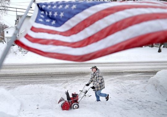 Jan White clears snow from his driveway Monday, Jan. 28, 2019, following a winter snowstorm that made its way through Janesville, Wis., overnight. Democratic Wisconsin Gov. Tony Evers declared a state of emergency shortly after noon Monday, citing the snow and severe cold that is forecast for the days ahead.