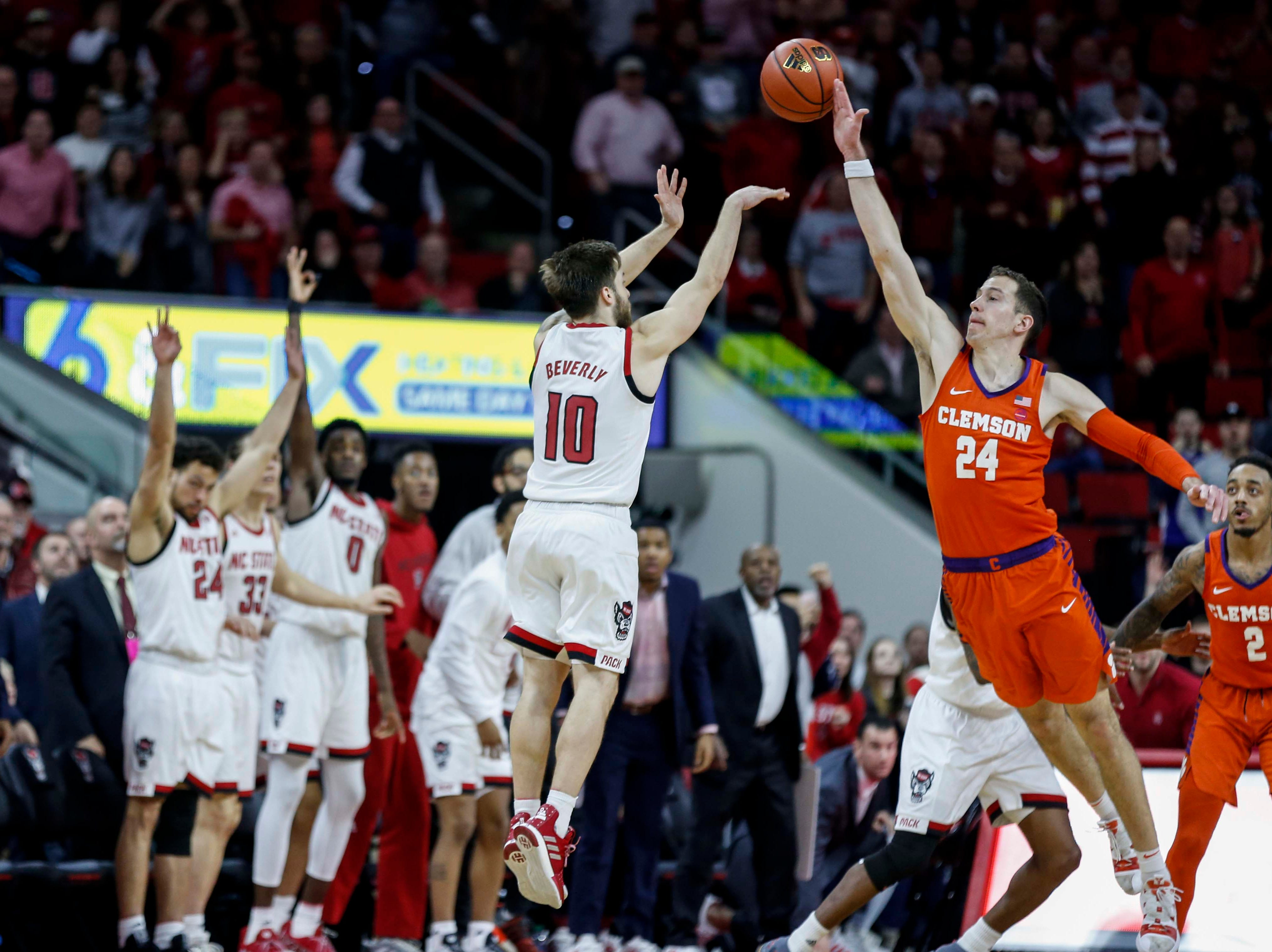 Jan 26, 2019; Raleigh, NC, USA; North Carolina State Wolfpack guard Braxton Beverly (10) shoots over a three-pointer over Clemson Tigers forward David Skara(24) as time expires in the second half at PNC Arena. North Carolina State Wolfpack won 69-67. Mandatory Credit: Nell Redmond-USA TODAY Sports