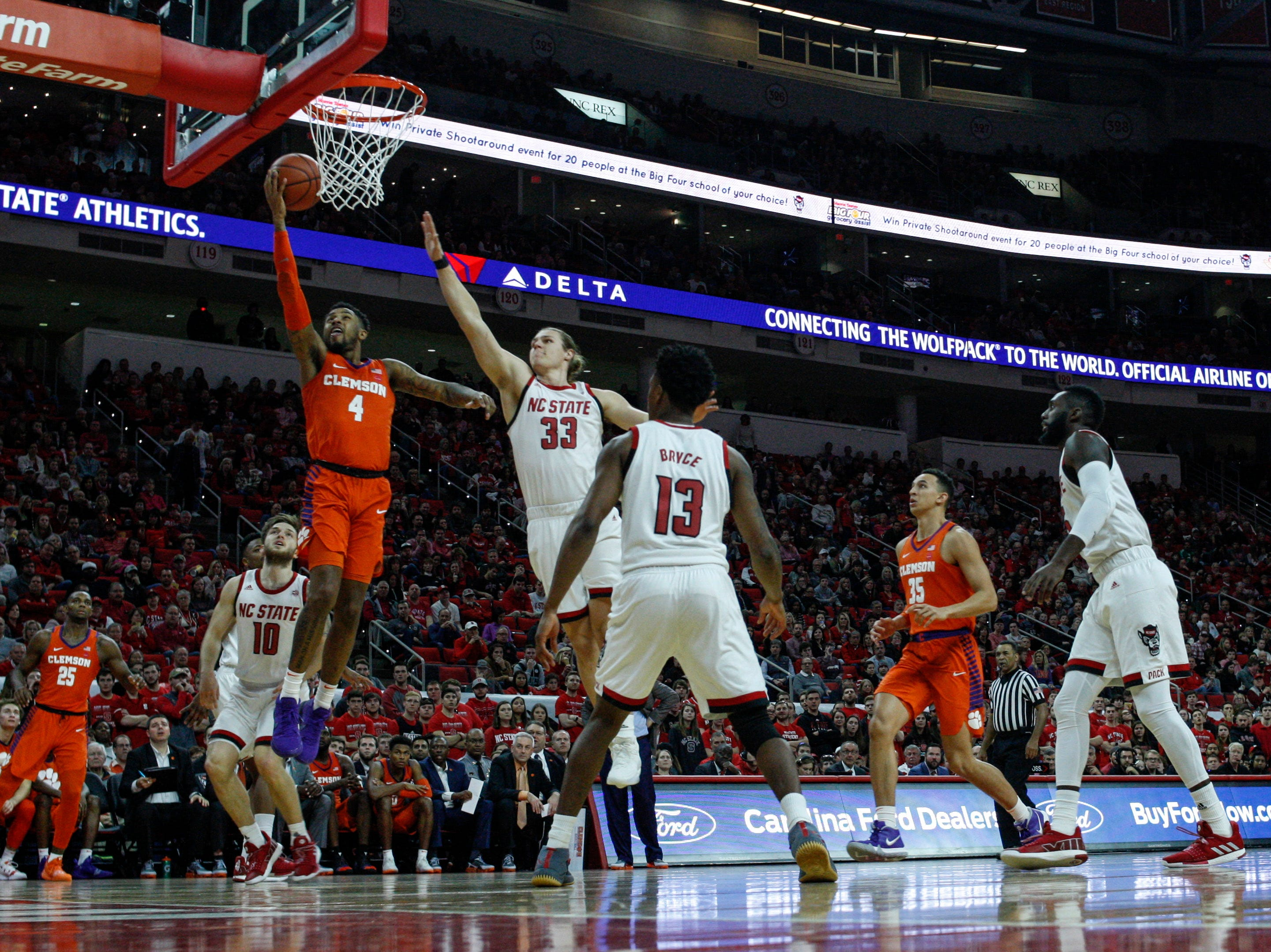 Jan 26, 2019; Raleigh, NC, USA; Clemson Tigers guard Shelton Mitchell (4) drives to the basket against North Carolina State Wolfpack forward Wyatt Walker (33) in the second half at PNC Arena. North Carolina State Wolfpack won 69-67. Mandatory Credit: Nell Redmond-USA TODAY Sports