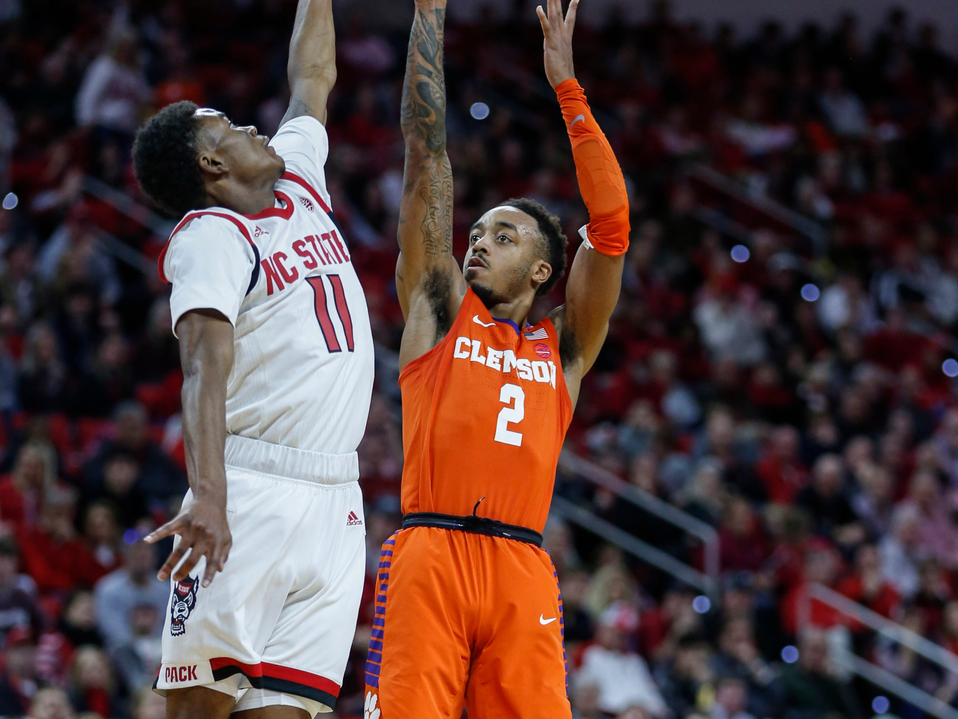 Jan 26, 2019; Raleigh, NC, USA; Clemson Tigers guard Marcquise Reed (2) shoots the ball over North Carolina State Wolfpack guard Markell Johnson (11) in the second half at PNC Arena. Mandatory Credit: Nell Redmond-USA TODAY Sports