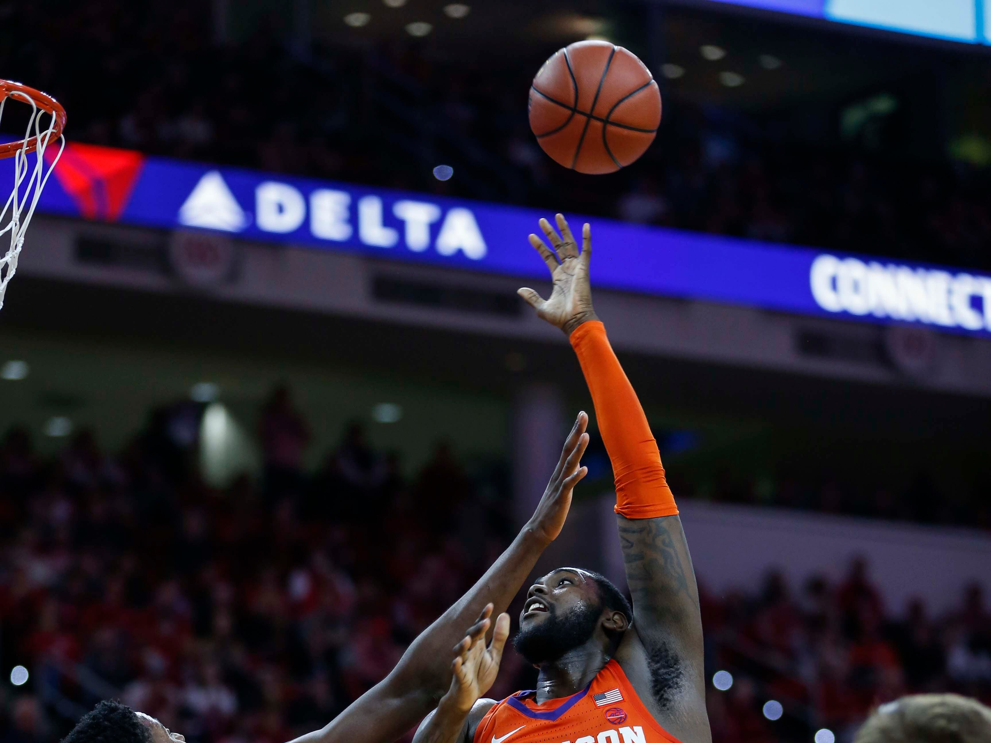 Jan 26, 2019; Raleigh, NC, USA; Clemson Tigers forward Elijah Thomas (14) shoots over North Carolina State Wolfpack forward DJ Funderburk (0) as North Carolina State Wolfpack guard Braxton Beverly (10) looks on in the second half at PNC Arena. North Carolina State Wolfpack won 69-67. Mandatory Credit: Nell Redmond-USA TODAY Sports