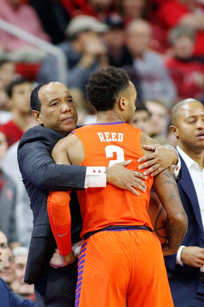 Jan 26, 2019; Raleigh, NC, USA; Clemson Tigers guard Marcquise Reed (2) collides with North Carolina State Wolfpack head coach Kevin Keatts in the first half at PNC Arena. Mandatory Credit: Nell Redmond-USA TODAY Sports