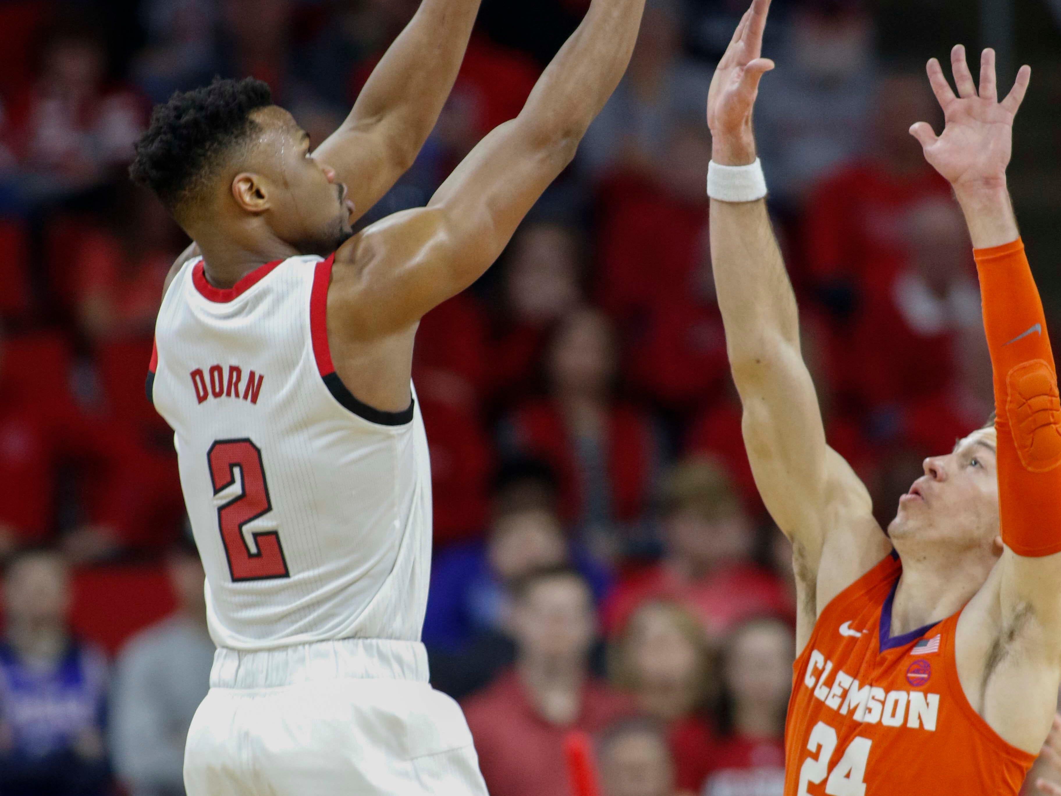 Jan 26, 2019; Raleigh, NC, USA; North Carolina State Wolfpack guard Torin Dorn (2) shoots over Clemson Tigers forward David Skara (24) in the second half at PNC Arena. North Carolina State Wolfpack won 69-67. Mandatory Credit: Nell Redmond-USA TODAY Sports