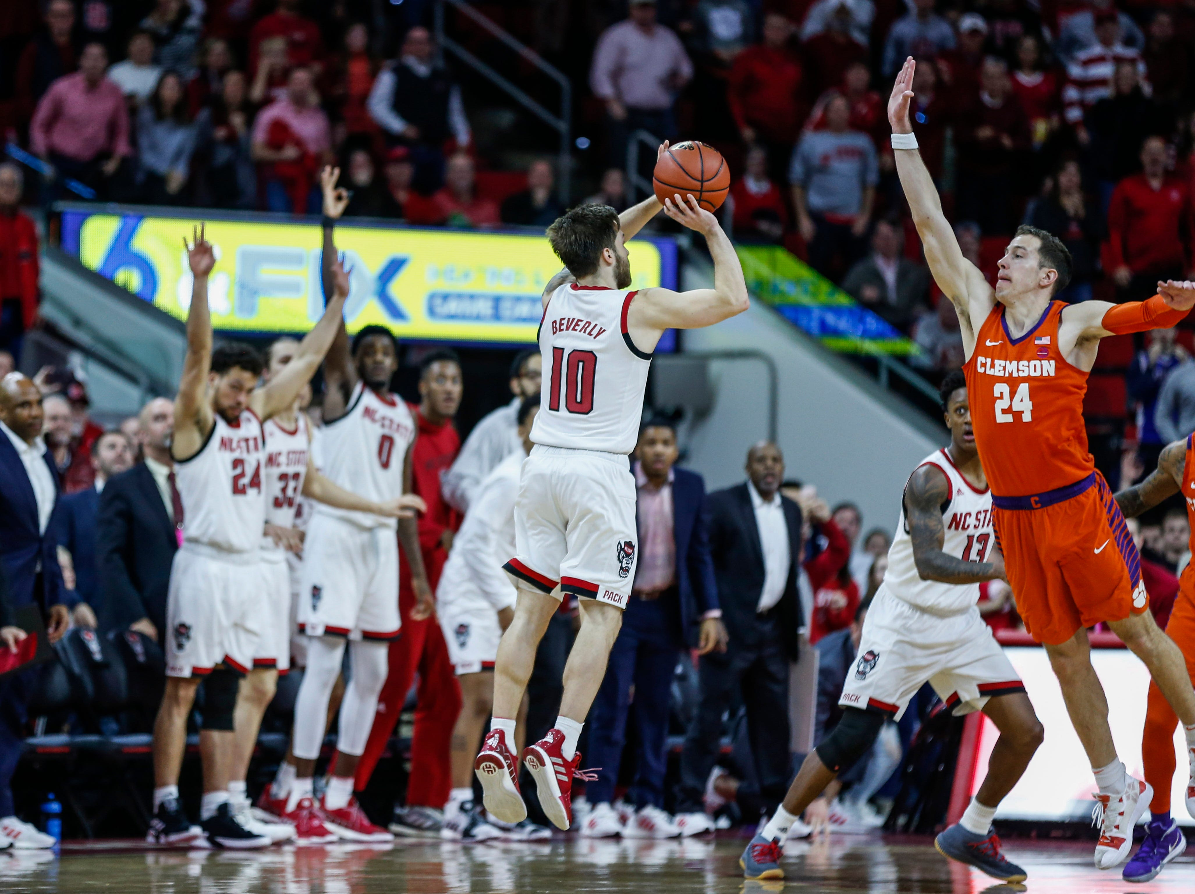 Jan 26, 2019; Raleigh, NC, USA; North Carolina State Wolfpack guard Braxton Beverly (10) shoots over a three-pointer over Clemson Tigers forward David Skara(24) as time expires in the second half at PNC Arena. Mandatory Credit: Nell Redmond-USA TODAY Sports