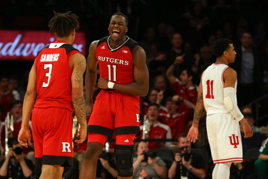 Rutgers Scarlet Knights forward Eugene Omoruyi (11) against Indiana Hoosiers guard Devonte Green (11) during the second half of a second round game of the 2018 Big Ten Tournament at Madison Square Garden.