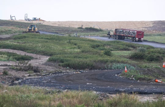 Compacted garbage is trucked to the landfill site at the Monmouth County Reclamation Center in Tinton Falls.  .