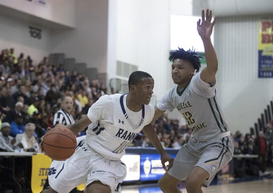 Scottie Lewis (left) shown here against Roselle Catholic in last season's NJSIAA Non-Public B final, will lead Ranney against the  Lions on Wednesday evening at Brookdale