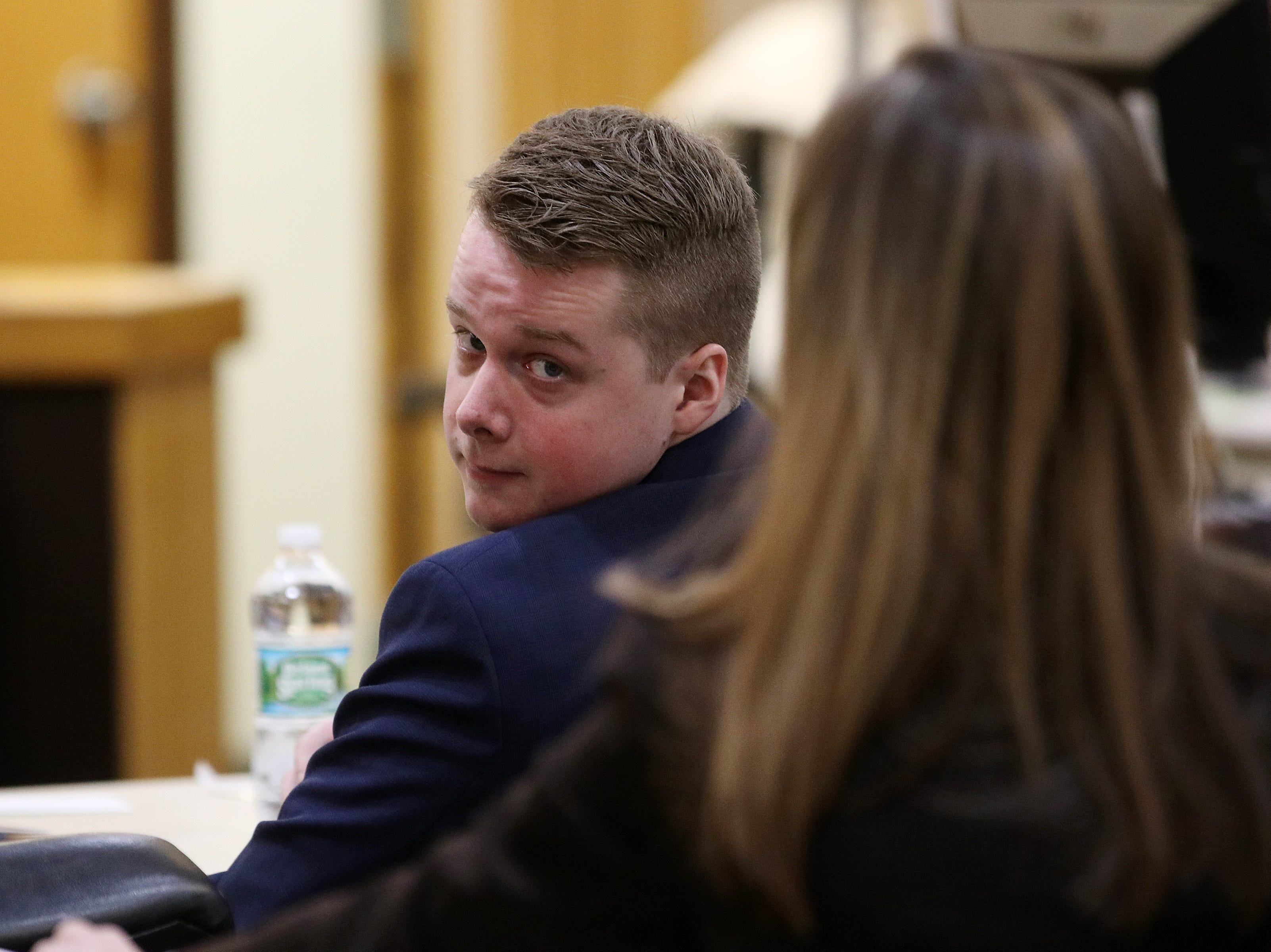 Liam McAtasney, who is charged with the murder of former high school classmate, Sarah Stern, looks back at his family members during the fourth day of trial before Superior Court Judge Richard W. English at the Monmouth County Courthouse in Freehold, NJ Tuesday January 29, 2019.