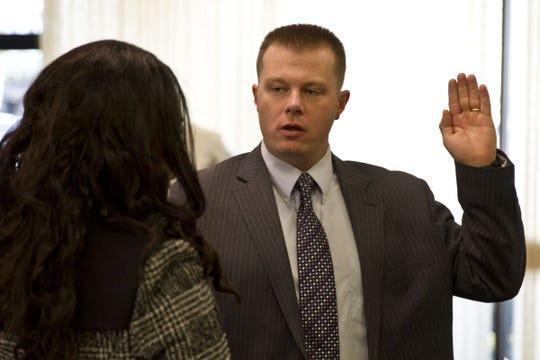 Terrence McGhee being sworn in as an Asbury Park Police officer on Jan. 2, 2015.