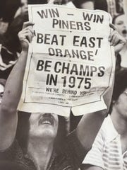A Lakewood fan at Brookdale for the 1975 NJSIAA Group III final between the Piners and No. 1 East Orange.
