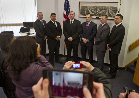 Terrence McGhee, second from right, is sworn in as an Asbury Park Police officer on Jan. 2, 2015.