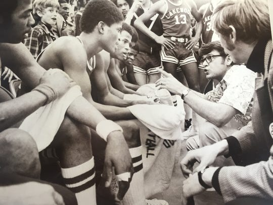 Lakewood head coach Bob Nastase talks to his players during a timeout at the 1975 NJSIAA Gropup III final against No. 1 East Orange at Brookdale.
