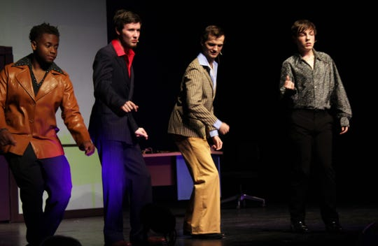 """From left: Emile Niyonkuru, Zachry Valentine, Jeremiah Cottle and Conner James put some '70s moves in """"Sister Act,"""" Cooper High School's winter musical."""