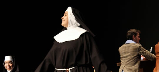 """A nun (Adriana Lara) gets an eyeful at a local night in this rehearsal scene from Cooper High's """"Sister Act."""""""